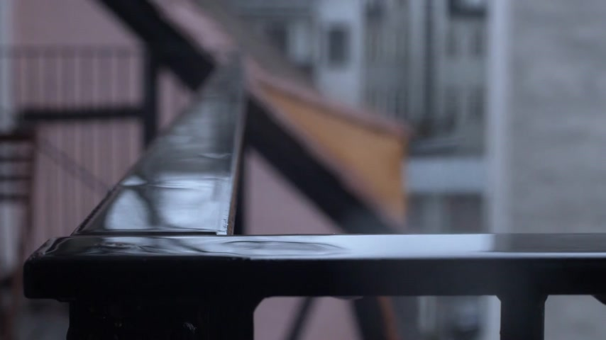 copenhagen : Huge rain drops in slow motion on a balcony in the city.