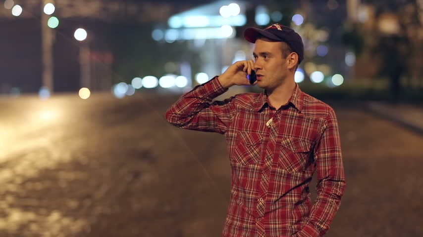 charisma : Man Talking With Phone at Night City Stock Footage