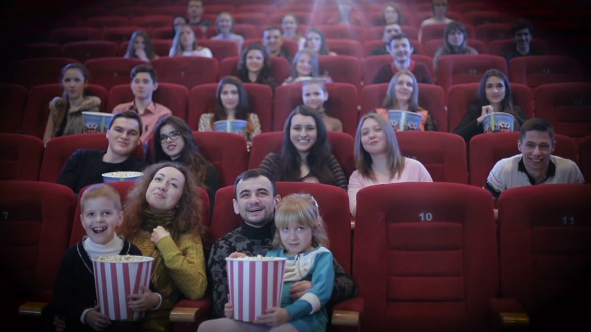 kino : people watching movie in cinema