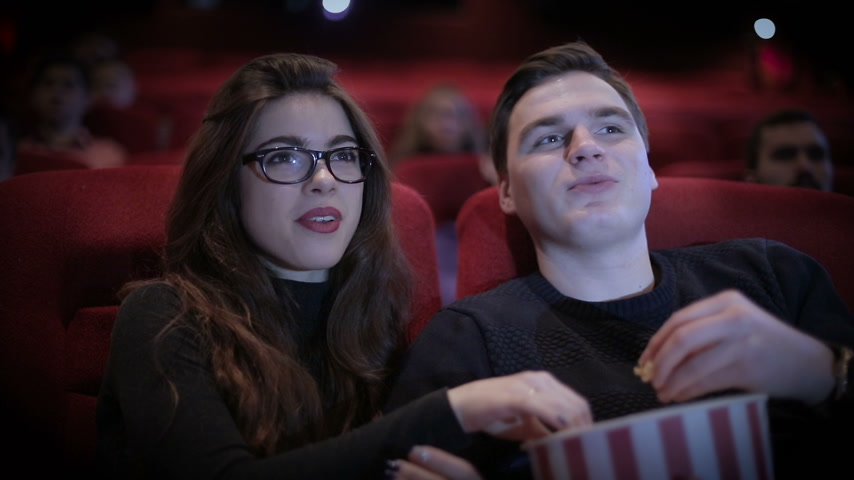kino : Romantic Couple waching a movie at cinema
