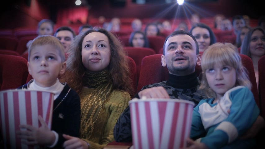 pozitivity : people watching movie at cinema and laughing