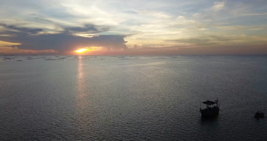 Aerial view of sea surface traveling around with beautiful sunset showing boats in water, drone shot, videography. Vídeos