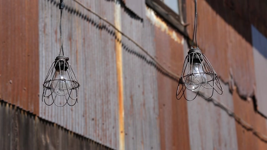 ahır : old light bulb in abandoned barn on the wind