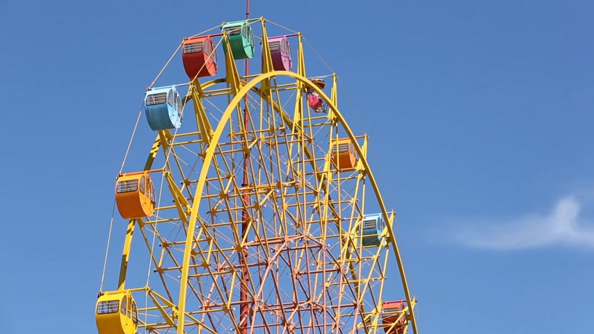 giant wheel : view of a ferris wheel against the blue sky