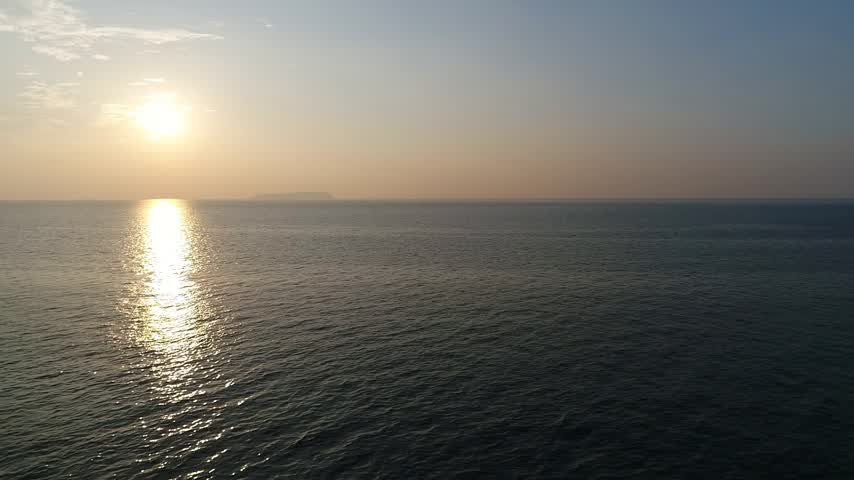 natural tranquil : aerial drone flying, aerial view, dolly in of calm evening sea