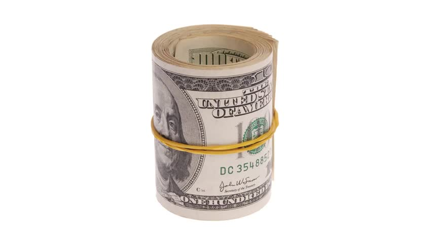 tekercselt : Roll of money rotates on a white background. Roll of bills. Roll of dollar bills. ENDLESS LOOP.