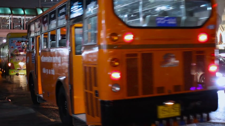 usual : BANGKOK, THAILAND - Usual street life in Bangkok. Road traffic in night. Cars and buses.