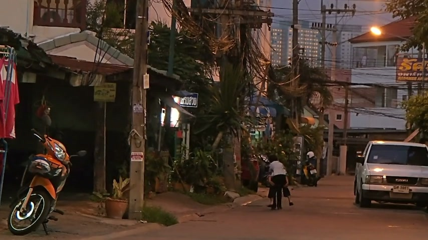 usual : PATTAYA, THAILAND - October 20, 2012. Usual street life. Man driving motorbike, children playing on street. Stock Footage