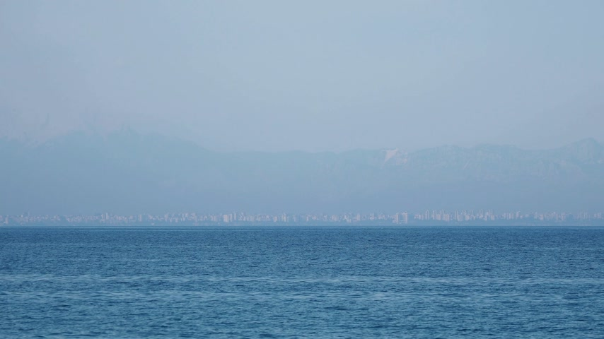 settlement : View on Antalya city through harbour from Kemer. Turkey.