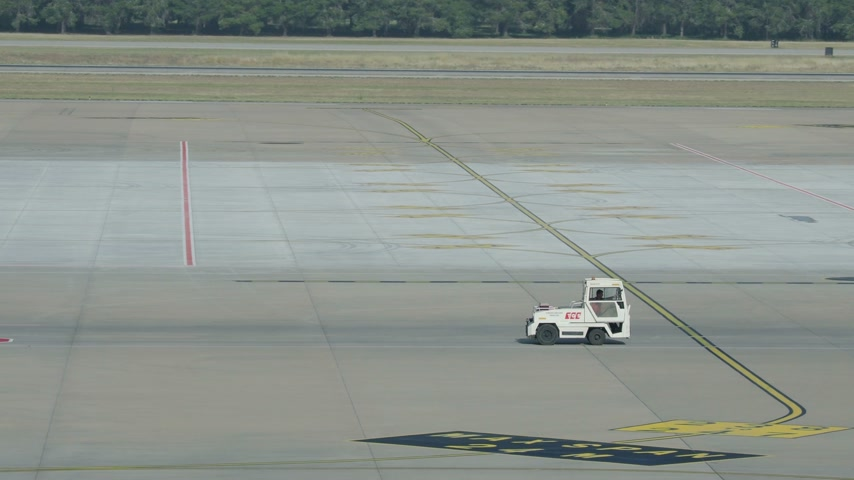 metin alanı : ANTALYA, TURKEY - May 22, 2018. Small special-purpose truck moving on the takeoff field of the airport. Stok Video