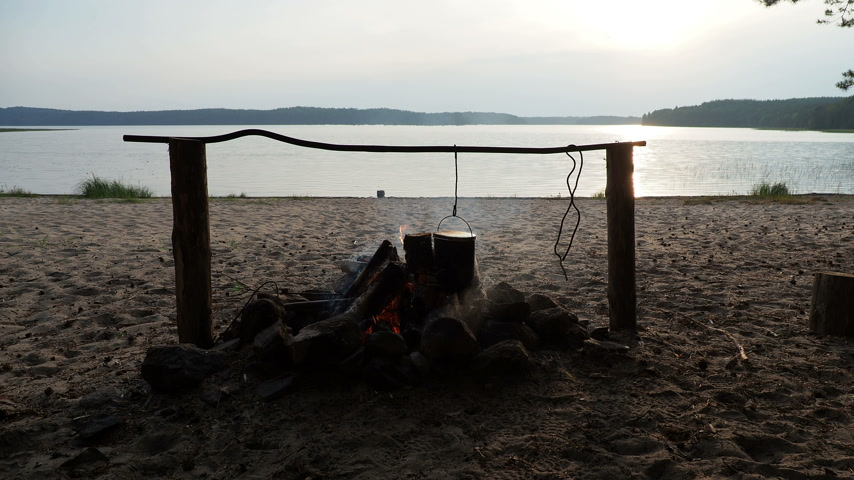 lenha : Cooking soup on a fire pot. Summer camping on beach. Kenozero national park, Russia.