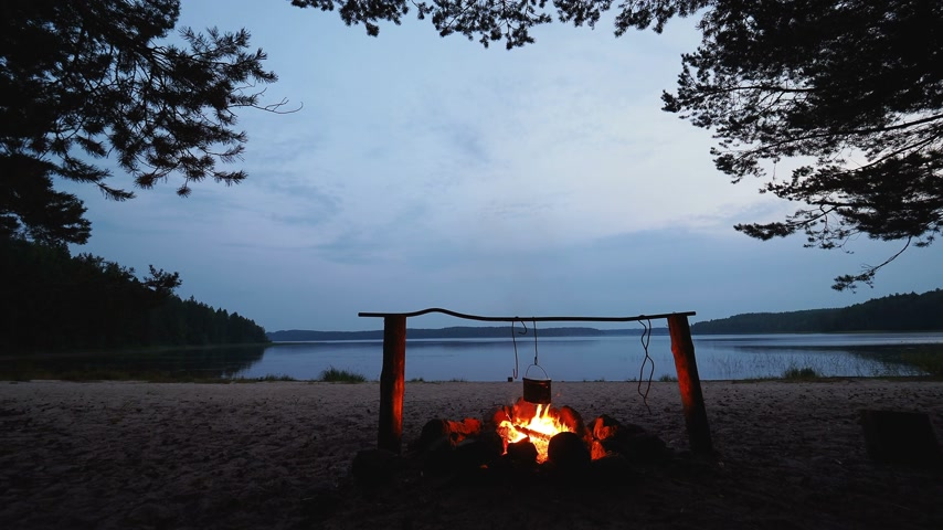 ゆでた : Cooking soup on a fire pot. Summer camping on beach. Kenozero national park, Russia.