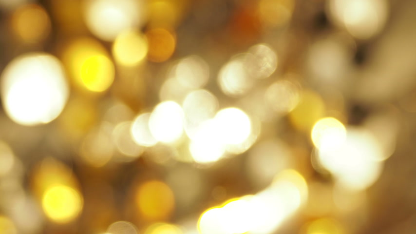 defocus : Defocused light reflections of golden sparkling fabric. Blurred colorful bokeh background Stock Footage