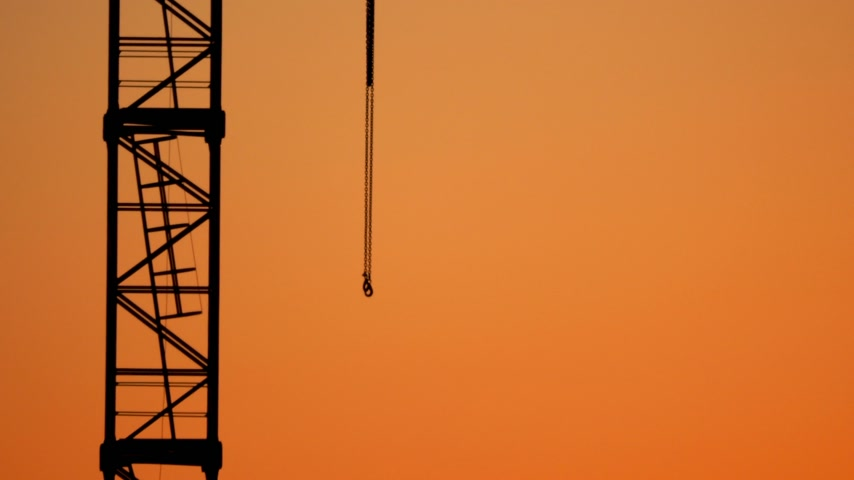 арматура : Construction crane on the background of an orange sunset.