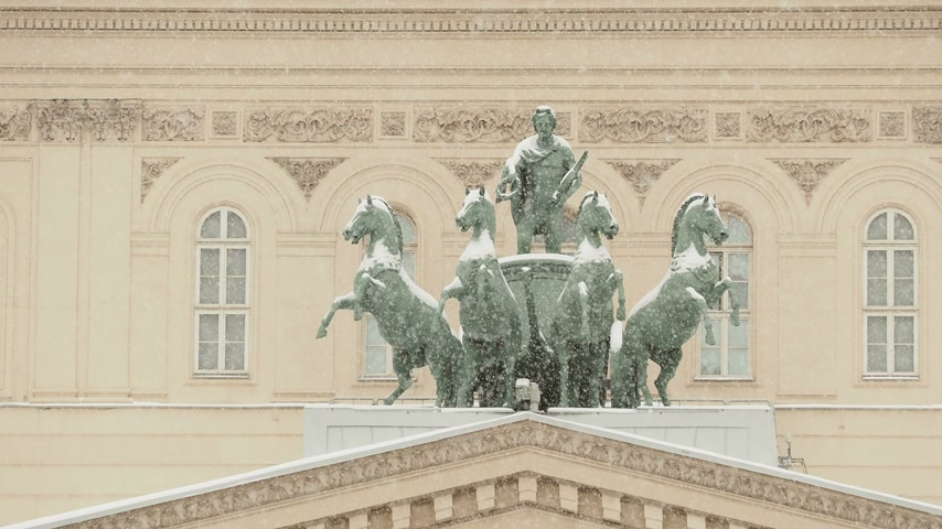 muse : Bronze sculpture of god Apollo on quadriga of his muses on Bolshoi Theatre. Moscow, Russia.