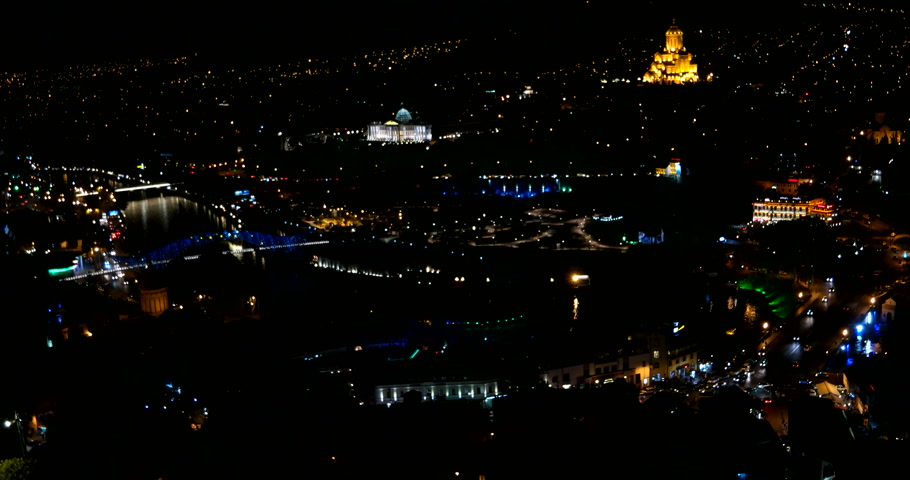 adminisztratív : Night panorama view of Tbilisi capital of Georgia country. Metekhi church Holy Trinity Cathedral (Sameba) and Presidential Administration at night with illumination and moving cars