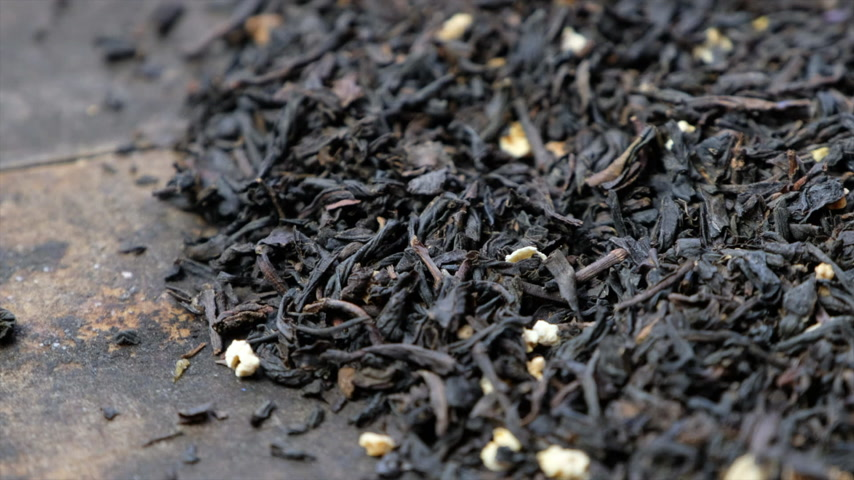 black tea : Rotating loose earl grey black tea leaves. Stock Footage