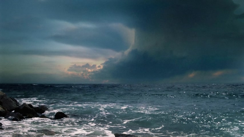 impending : Cinematic storm clouds with lightning strikes reflecting in ocean. Stock Footage