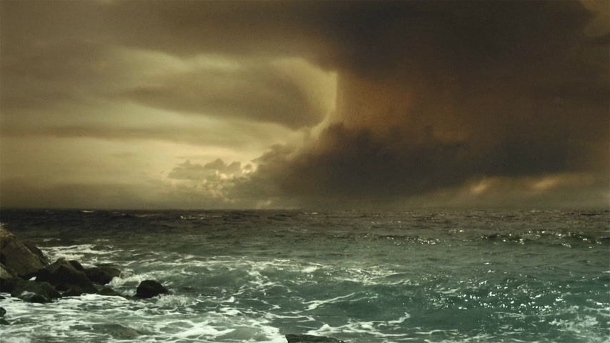 impending : Cinematic storm clouds with lightning strikes reflecting in ocean. Sepia tint.