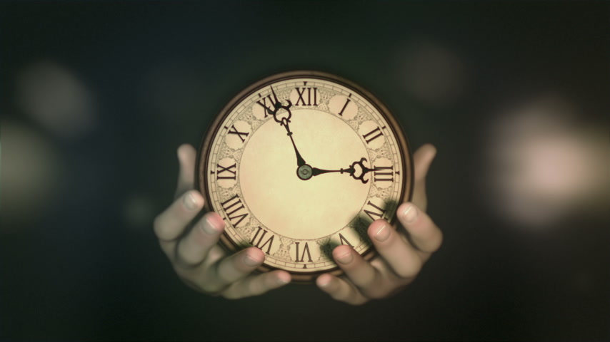 múlt : Passing of time. Hands holding fast turning clock. Natural grading version.