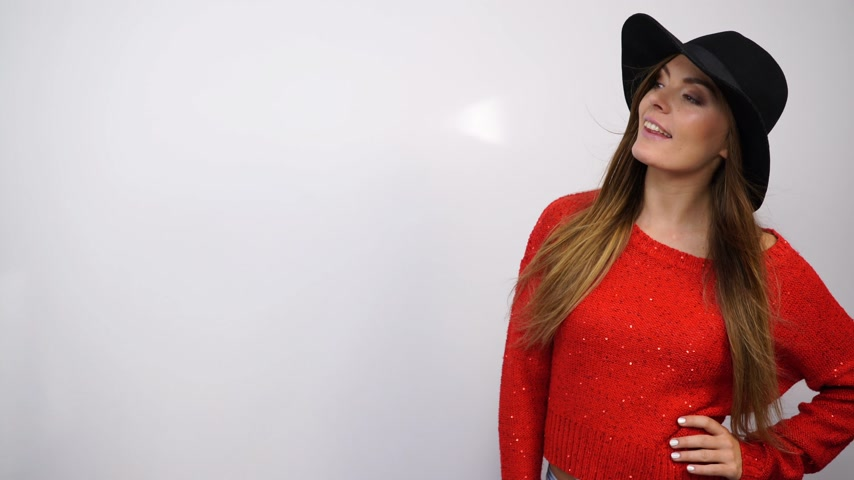 smile : Woman looking at empty blank copyspace. Happy smiling young girl in hat and red sweater. 4K ProRes HQ codec