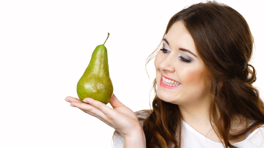 груша : Charming woman holds pear fruit, isolated Стоковые видеозаписи