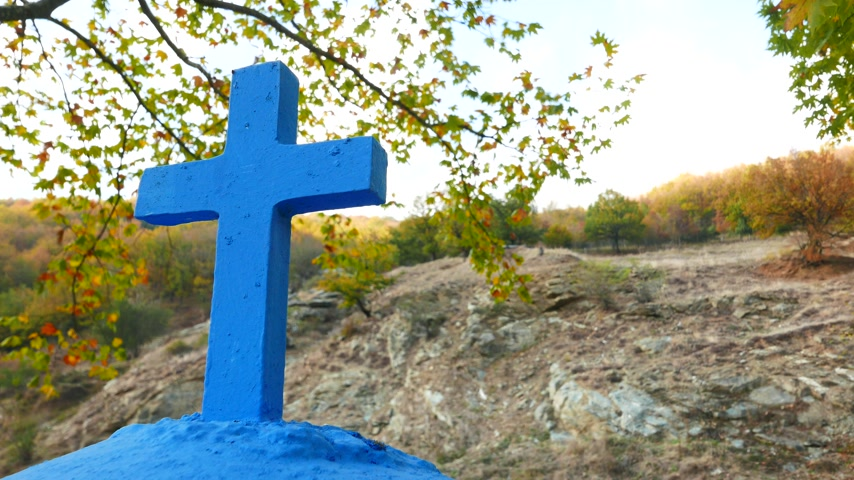crucifix : Greek cross in autumn scenery 4K