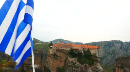 greek flag : View of Varlaam monastery in Meteora, Greece Stock Footage