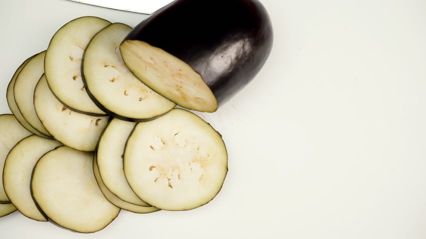 eggplant : Sliced ??eggplant vegetable on white board 4K