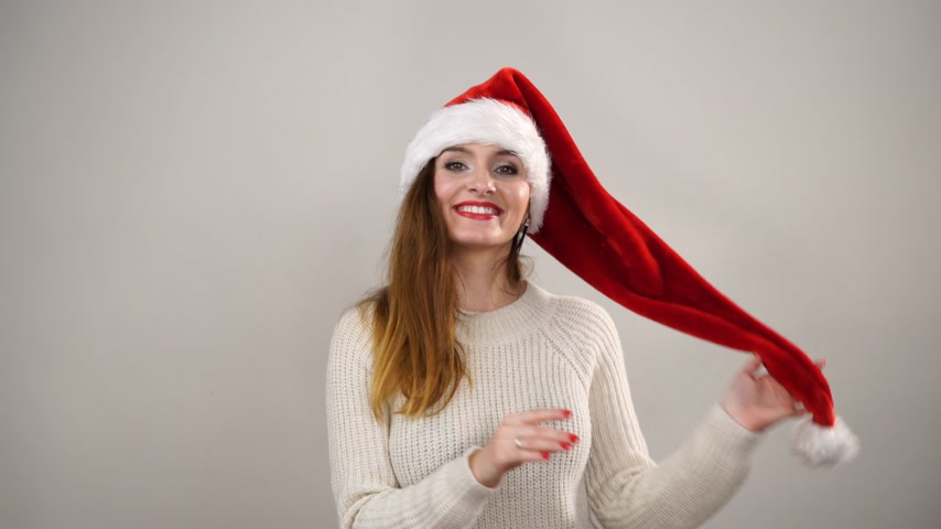 peluş : Woman playing with santa claus helper hat. Pretty happy girl. Christmas season. 4K ProRes HQ codec.
