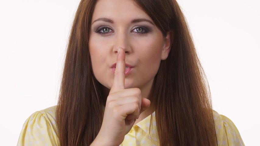 taboo : Woman asking for silence with finger on lips Stock Footage