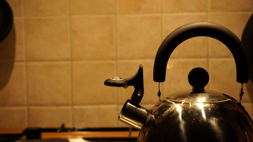 gas hob : Boiling kettle on the stove with steam emitted from spout. 4K