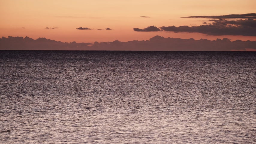 peloponnese : Red orange sky after sunset over sea surface Stock Footage