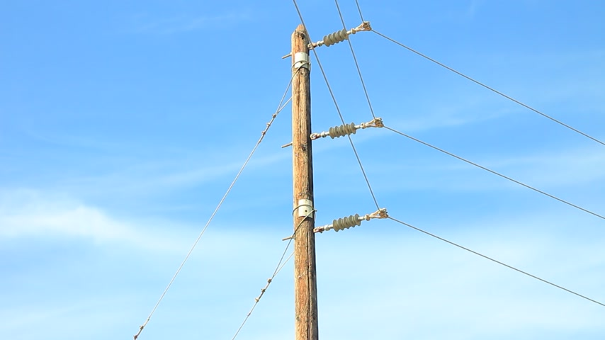 powerline : Power line voltage tower against blue sky time lapse Stock Footage