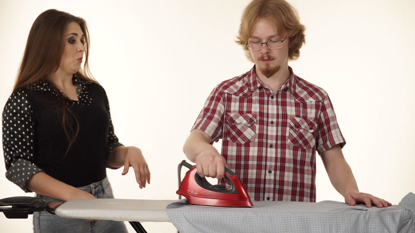 ütüleme : Funny couple irons clothes on ironing board 4K