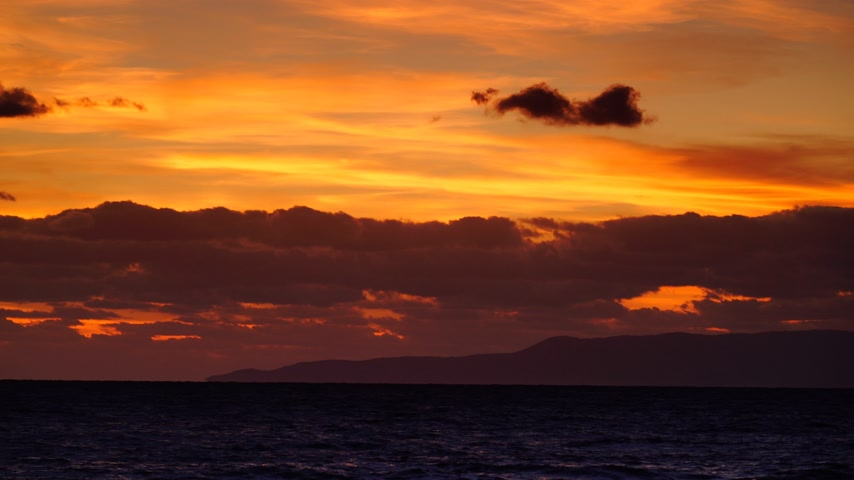peloponnese : Sunset over sea surface, dark clouds. Time lapse Stock Footage