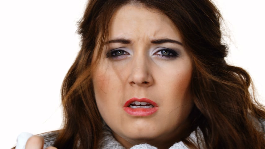 tremble : Sick freezing woman sneezing in tissue