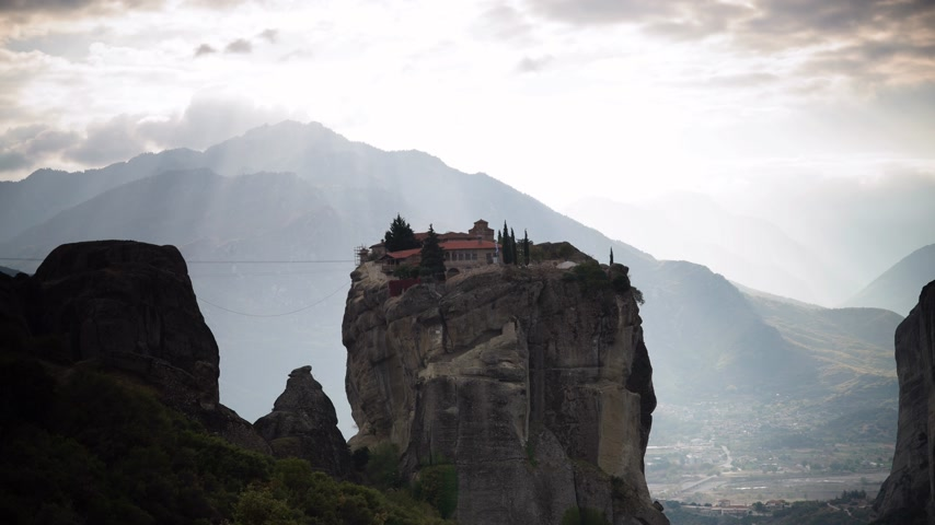 convento : Clouds and sunshine over Trinity monastery in Meteora, Greece