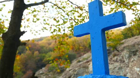 crucifix : Greek blue christian cross in autumn scenery 4K