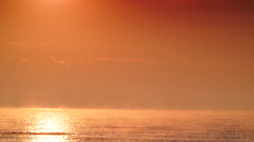 grecja : Sunrise over sea surface