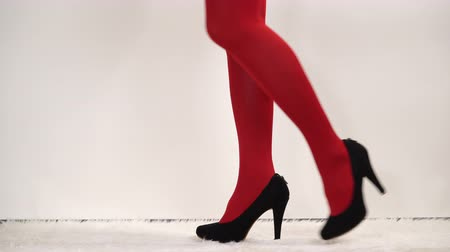 чулки : Woman in high heels and pantyhose. Fashionable girl wearing black shoes. Female fashion. 4K ProRes HQ codec.