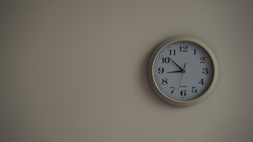 clockface : Wall clock ticking showing nine hours, timelapse