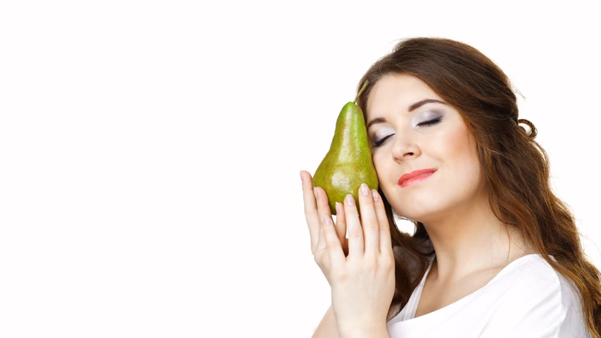 vitamin c : Woman holding pear fruit, isolated. Healthy diet.