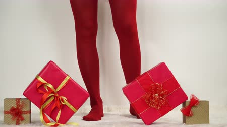 stockings : Woman in red pantyhose taking christmas presents gifts boxes. 4K ProRes HQ codec.