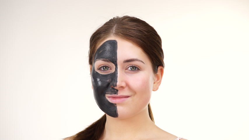 cuidados com a pele : Woman with black carbo mask on face