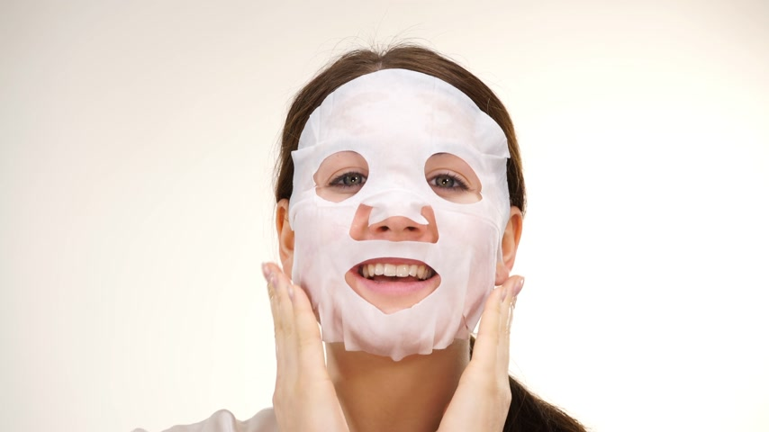 sheet : Woman applying sheet mask on face Stock Footage