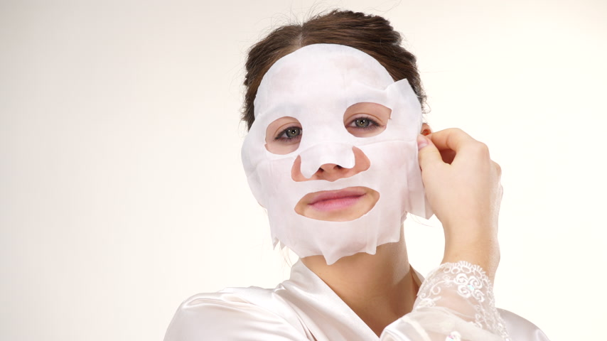 sheet : Woman removing sheet mask from face Stock Footage