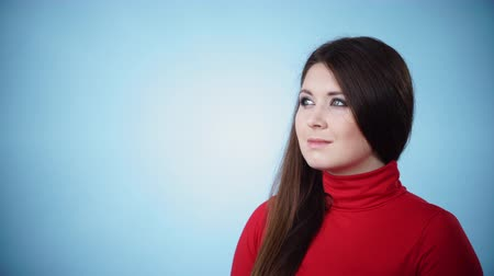 beside : Woman in red polo neck looking at beside Stock Footage