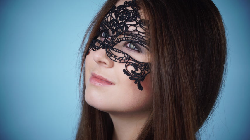 seduce : Woman face with black carnival mask 4K