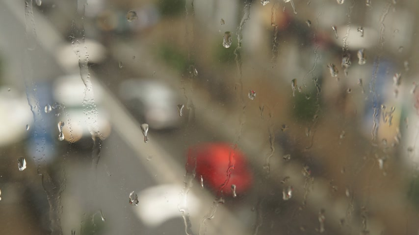pane : Aerial view of city traffic, rainy cold day 4K